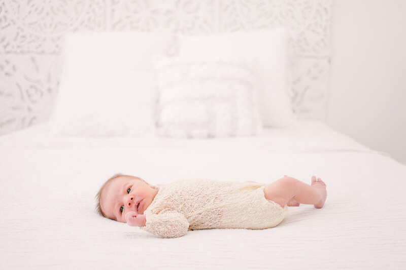 how to take baby photos on a bed